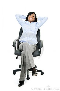relaxed-businesswoman-sitting-on-office-chair-thumb21119916